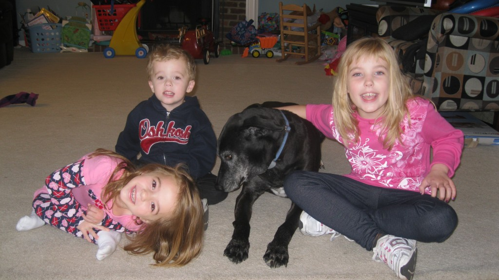 Maddie at 8 with her 3 siblings.
