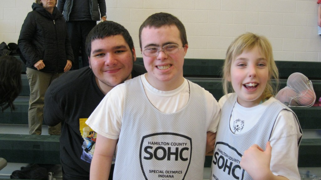 With her friends Robert and John before special olympics bball practice.