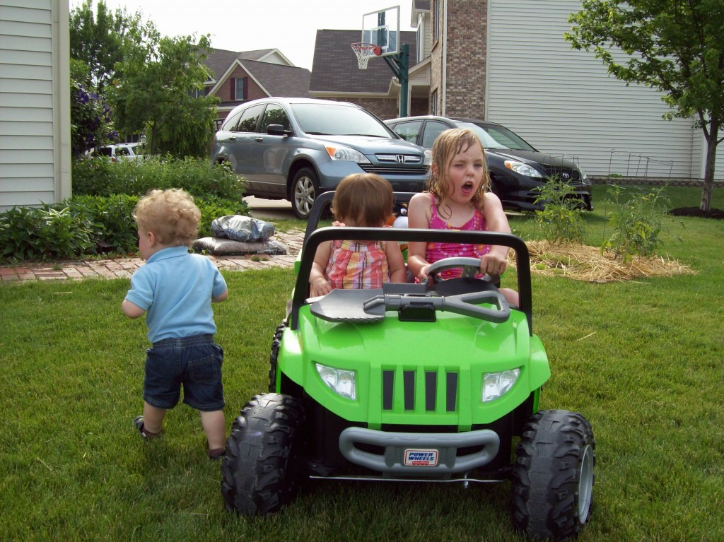 Maddie at 7, the last year she could comfortably fit into her jeep.
